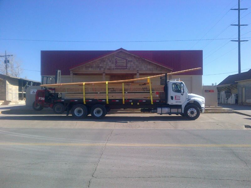 Flatbed In Front of Store